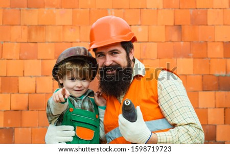 Best team ever. Happy father and son build their house together. Male work. Builders, construction business. #1598719723