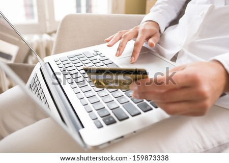 Woman's hands holding a credit card and using laptop for online shopping #159873338