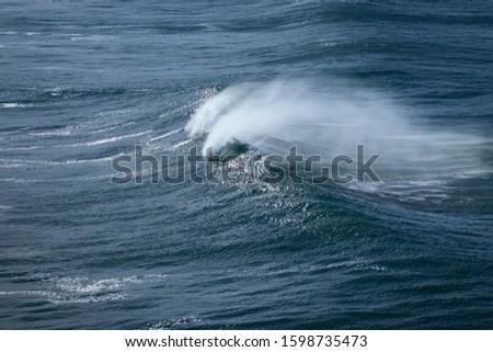 Big breaking Ocean wave. Strong wave #1598735473