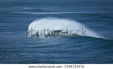Big breaking Ocean wave. Strong wave #1598735476