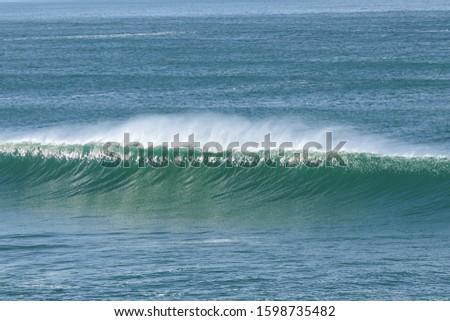 Big breaking Ocean wave. Strong wave #1598735482