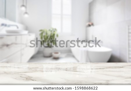 Table Top And Blur Bathroom Of The Background Royalty-Free Stock Photo #1598868622