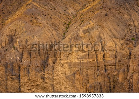 Gully erosion is a water erosion, prominent in arid cold desert landscape of Spiti due to barren steep slopes & weak unconsolidated geological surface mud rocks in Trans  Himalayas of Himachal Pradesh #1598957833