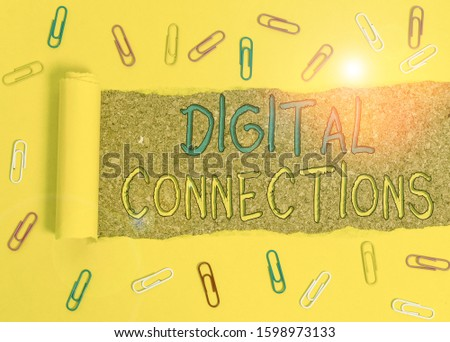 Text sign showing Digital Connections. Conceptual photo the online way to explore and build relationships Paper clip and torn cardboard placed above a wooden classic table backdrop. #1598973133