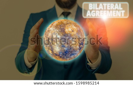 Conceptual hand writing showing Bilateral Agreement. Business photo showcasing Legal obligations to nonbinding agreements of principle Elements of this image furnished by NASA. #1598985214