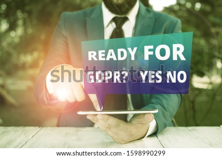 Text sign showing Ready For Gdpr question Yes No. Conceptual photo Readiness General Data Protection Regulation Businessman with pointing finger in front of him. #1598990299