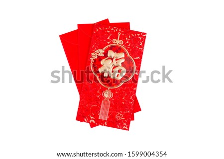Translation text on red envelope in image: Prosperity and Spring.Giving red envelope for Chinese New Year or Lunar New Year celebrations mean all things going smooth and well. Royalty-Free Stock Photo #1599004354