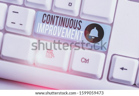 Text sign showing Continuous Improvement. Conceptual photo ongoing effort to improve products or processes White pc keyboard with empty note paper above white background key copy space. #1599059473