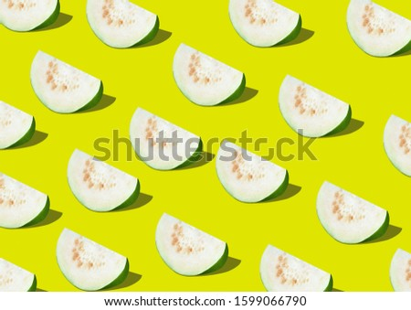 GUAVA fruit on pastel background flat lay on background whole guava and sliced guava pattern background green guava #1599066790