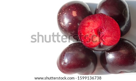 Plum Fruit tree with small juicy edible fruits, which have a large bone,. an oval fleshy fruit that is purple, reddish, or yellow when ripe and contains a flattish pointed pit. #1599136738