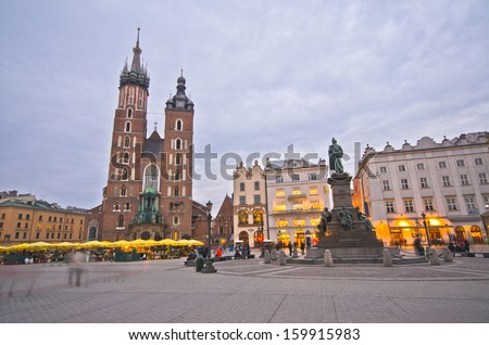 KRAKOW, POLAND - MARCH 10: St. Mary's Church in historical center of Krakow, March 10, 2012 in Krakow, Poland. This year the city was visited by 8.1 million tourists, which is the highest level. #159915983