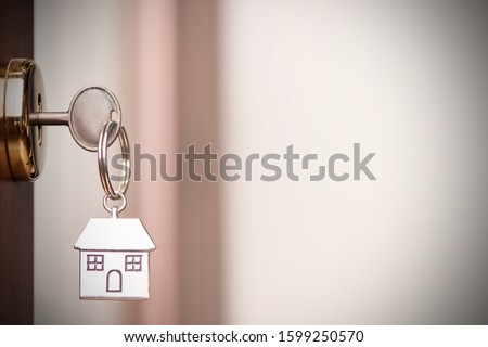 House key in the door. Close up #1599250570