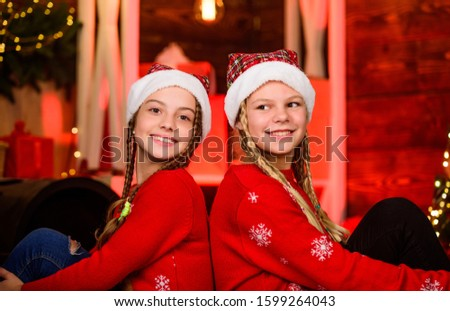 Sisterhood concept. Girls friends sisters braided hairstyle. Playful kids. Happy holidays. December holidays. Holidays and vacation. Children having fun christmas eve. Happiness joy. Family values. #1599264043