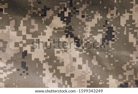 The Universal Camouflage Pattern, also referred to as Army Combat Uniform Pattern) or Digital military camouflage. Background. Royalty-Free Stock Photo #1599343249