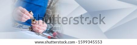 Plumber hands using plumbing fittings, light effect; panoramic banner #1599345553