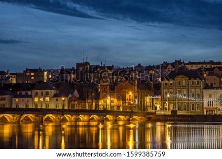Bideford`s ancient and iconic Long Bridge in North Devon at dusk Royalty-Free Stock Photo #1599385759
