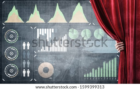Hand opening red curtain and drawing business graphs and diagrams behind it #1599399313