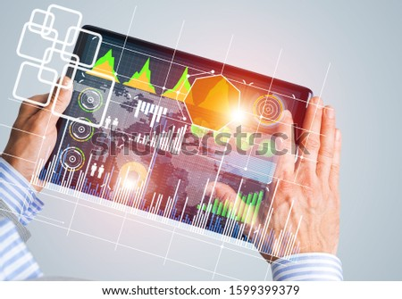 Close of businessman hands holding tablet pc with infographs on screen #1599399379