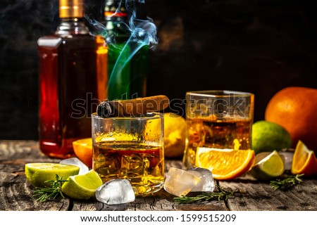 Elite drink for masculine relaxation. alcoholism, alcohol addiction and people concept - male alcoholic with bottle and glass drinking whiskey at night.Businessman drinks whiskey. #1599515209
