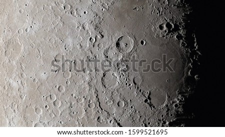Moon surface close up. Craters and furrows on the surface of the earth's satellite. (Elements of this image furnished by NASA) Royalty-Free Stock Photo #1599521695
