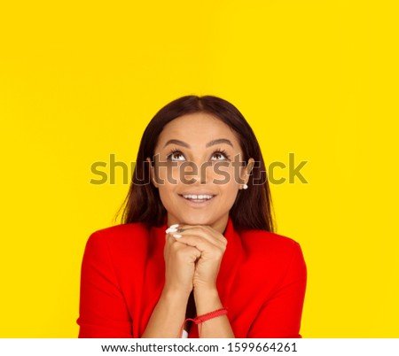Thinking business woman looking up smiling happy. Mixed race model isolated on yellow background with copy space. Horizontal image. #1599664261