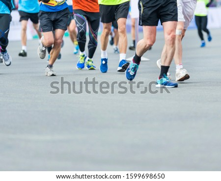 Group of marathon runners compete in the race #1599698650