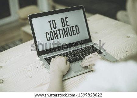 Writing note showing To Be Continued. Business photo showcasing indicate that the story continues in the next episode woman with laptop smartphone and office supplies technology. #1599828022