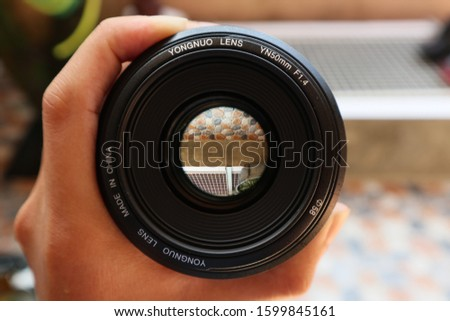 Yogyakarta, Indonesia - December 28, 2019. A 50mm lens for canon cameras purchased online. This lens is planned to be sold because it is too heavy. #1599845161
