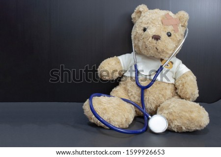 Children doctor concept  Teddy bear with stethoscope / Pediatrician. #1599926653