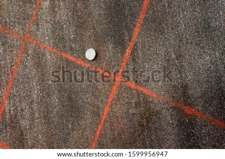 Slate covering roofing felt with roofing felt nail and red marking close up #1599956947