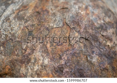detail of a rock with effect of thermal stress weathering and visible layers peeled away by exfoliation #1599986707