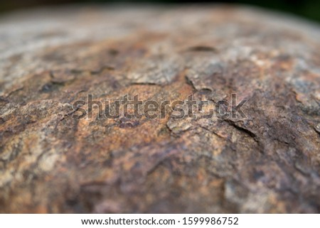 detail of a rock with effect of thermal stress weathering and visible layers peeled away by exfoliation #1599986752