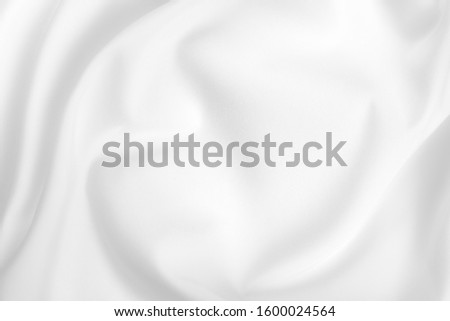 Abstract white fabric texture background. Cloth soft wave. Creases of satin, silk, and cotton. #1600024564