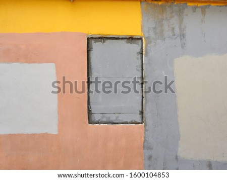 Abstract composition in the form of multi-colored rectangles depicted on the wall of an old building. #1600104853