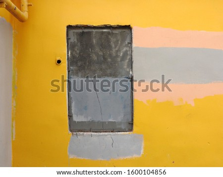 Abstract composition in the form of multi-colored rectangles depicted on the wall of an old building. #1600104856