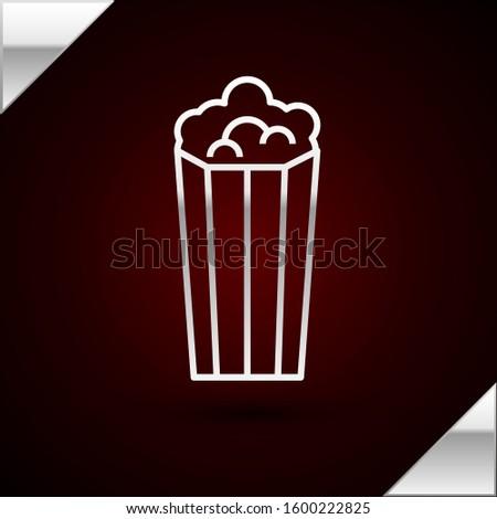 Silver line Popcorn in cardboard box icon isolated on dark red background. Popcorn bucket box.   #1600222825