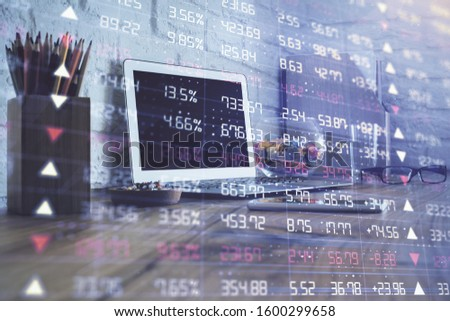 Stock market graph on background with desk and personal computer. Multi exposure. Concept of financial analysis. #1600299658