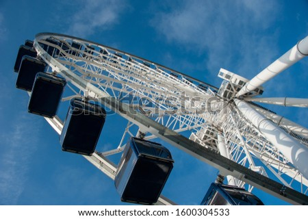 Chicago's Navy Pier Centennial Wheel Ferris wheel looking up from ground level showing white spokes against Deep Blue Sky