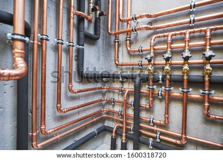 Plumbing service. copper pipeline of a heating system in boiler room Royalty-Free Stock Photo #1600318720