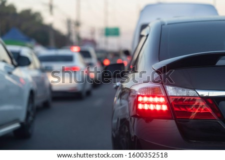Back light black car on street road traffic transport. #1600352518