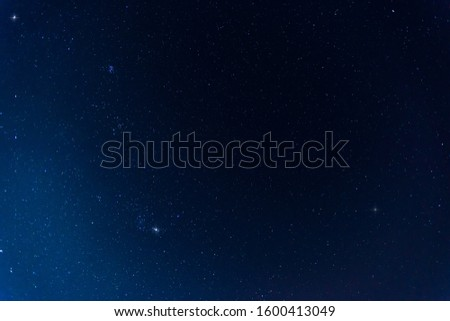 amazing Panorama blue night sky milky way and star on dark background.Universe filled with stars, nebula and galaxy with noise and grain.Photo by long exposure and select white balance.selection focus #1600413049
