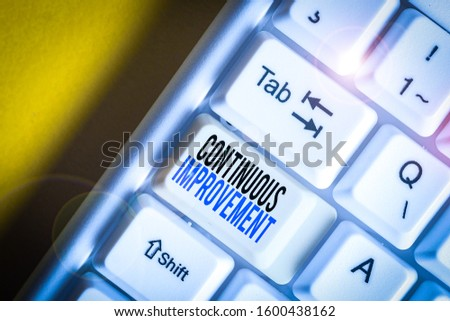 Writing note showing Continuous Improvement. Business photo showcasing ongoing effort to improve products or processes White pc keyboard with note paper above the white background. #1600438162
