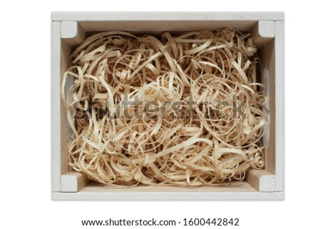 wooden shavings in a wooden box. background with wooden shavings #1600442842