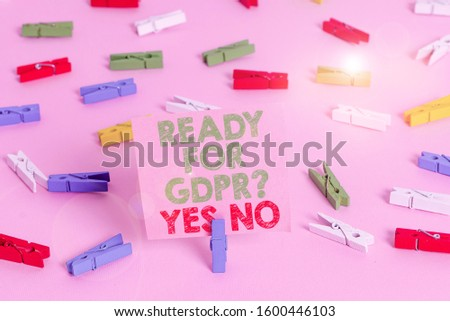 Text sign showing Ready For Gdpr question Yes No. Conceptual photo Readiness General Data Protection Regulation Colored clothespin papers empty reminder pink floor background office pin. #1600446103