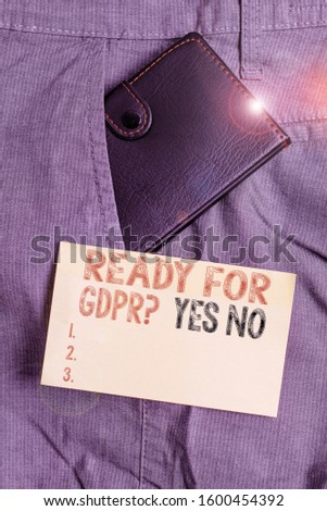 Writing note showing Ready For Gdpr question Yes No. Business photo showcasing Readiness General Data Protection Regulation Small wallet inside trouser front pocket near notation paper. #1600454392
