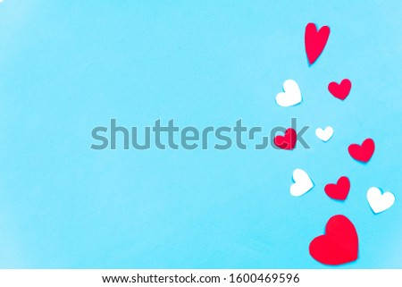 Valentines Day background. White and red hearts on pastel blue background. Valentines day concept. Top view,  copy space. #1600469596