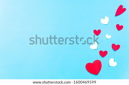 Valentines Day background. White and red hearts on pastel blue background. Valentines day concept. Top view,  copy space. #1600469599