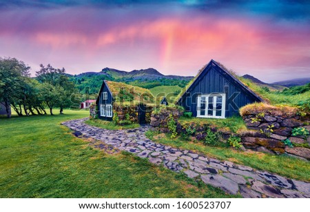 Typical view of Icelandic turf-top houses. Splendid summer sunrise on Skogar village. Fantastic morning scene of Iceland, Europe. Beauty of countryside concept background. #1600523707