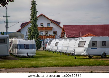 Campers Storage Parking with Many Recreational Vehicles in Row. #1600630564