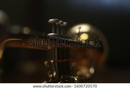 trumpet valve and piston section. detail shot. Shallow depth of field sharpness at the valve. #1600720570